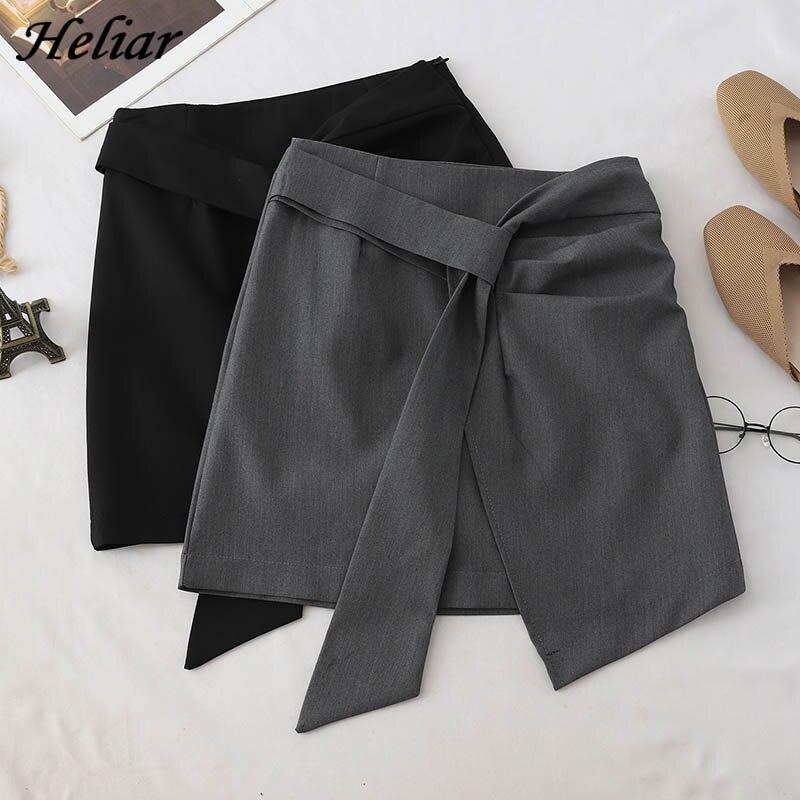 HELIAR Solid Skirt Irregular Hem A-Line Micro Beach Skirt Preppy Style Skirt With Sashes High Waist Street Femme Skirt For Women