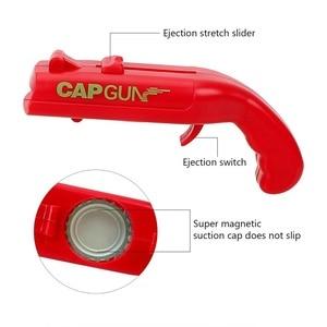 Image 2 - NEW Firing Cap Gun Creative Flying Cap Launcher Bottle Beer Opener