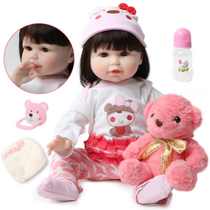 56CM Cute soft silicone reborn 22 inch lifelike soft body baby dolls Birthday Christmas girl gifts doll Play Toys With Pink bear(China)