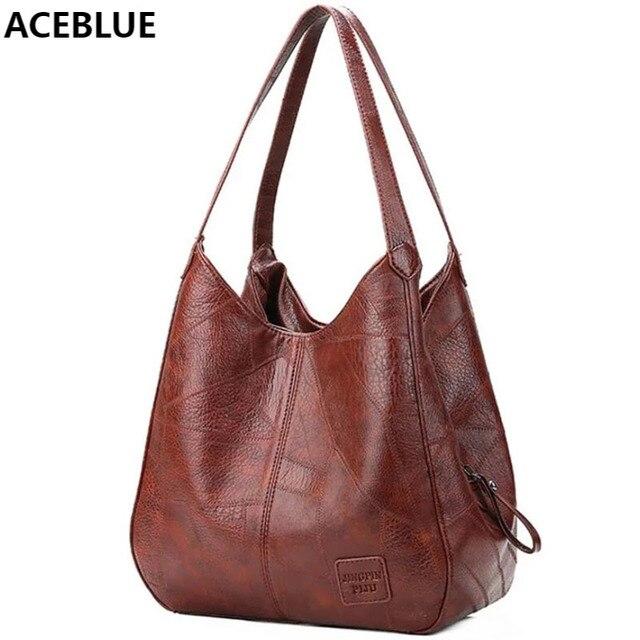 Женская кожаная сумка с ручками и тремя отделениями 1