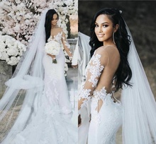 2021 Modest Mermaid Wedding Dress With Long Sleeves Illusion Top Sexy Open Back Sheer Neck Bridal Gowns Lace Appliqued Court