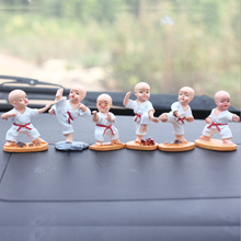 Creative resin crafts Manual coloured drawing car display cartoon doll kungfu little monk car dashboard toy cute car accessories cute chinese style couple s resin display toy doll sitting on peaches
