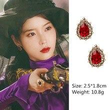 купить New Hot Popular Korean TV Red Crystal Water Drop Shape Earrings Rhinestone Small Simulated Pearl Eardrop for Women Brincos дешево