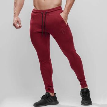 Spodnie dresowe dla joggerów mężczyźni dorywczo cienka bawełna spodnie sportowe siłownia trening spodnie treningowe męskie bieganie odzież sportowa spodnie do biegania tanie i dobre opinie GLOBESKY Na co dzień Sznurek Mieszkanie Pełnej długości Poliester COTTON skinny 28 - 40 NONE Sweatpants for men Midweight