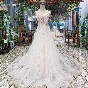 Image 1 - LSS508 ボヘミアンウェディングドレス v ネックノースリーブ a ライン格安ウェディングドレスシンプルなビーチブライダルドレス vestidos デ noiva 2020