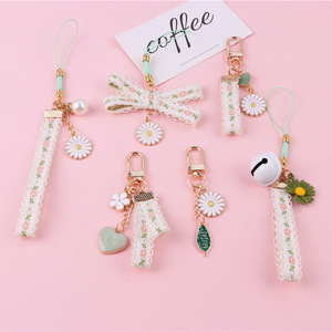 Cartoon Japan Small Daisy Flower Keychain For Women Key Chains Ring Bell Ribbon Car Bag Pendent Charm Airpods Accessories K41(China)