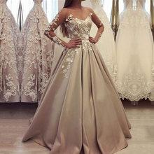 Атласное платье трапеция цвета шампанского с длинным рукавом