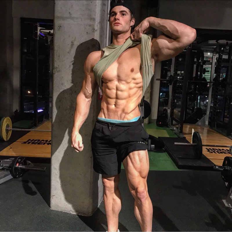 2019 nowe męskie siłownie Fitness luźne spodenki kulturystyka biegacze lato szybkie suche fajne krótkie spodnie męskie na co dzień plaża marki spodnie dresowe