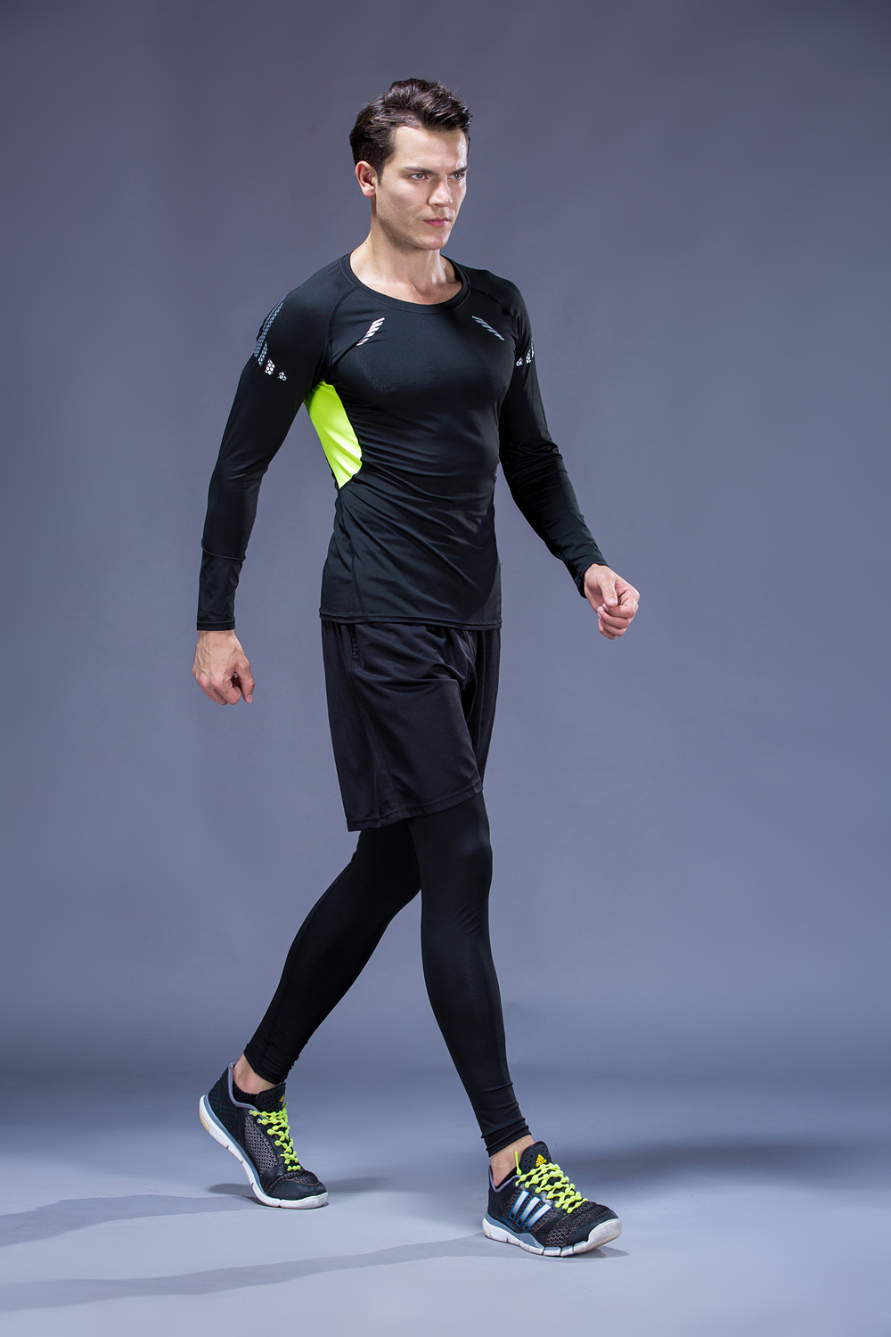 Foto from the left on men 5 pcs compressions clothes for gym. Men's 5 pcs compression tracksuit sports