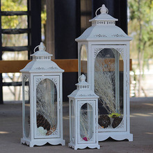 Factory Direct European Retro Hollow Storm Lantern Crafts Decorations and Ornaments Iron Glass Metal Candlestick Storm