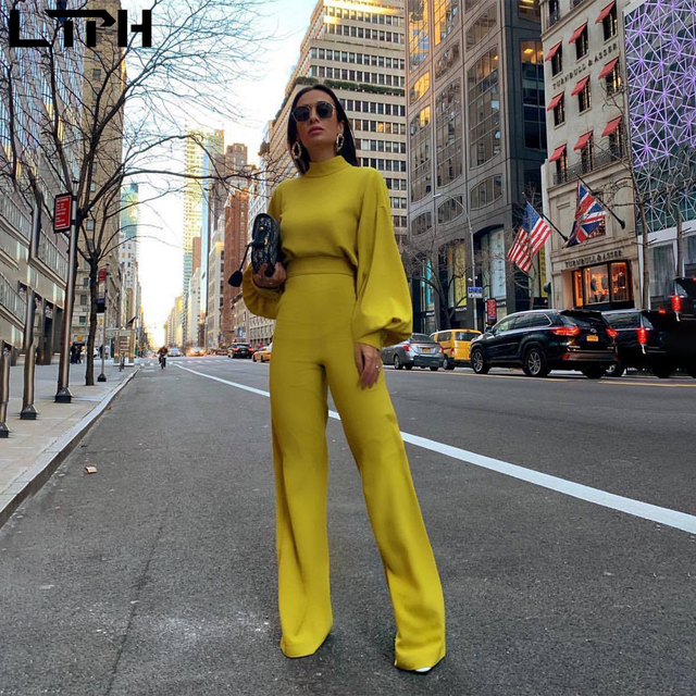 Hot sale 2019 autumn and winter new women jumpsuit Solid knit straight Ful sleeve lhigh collar hollow backless Long Siamese suit 1