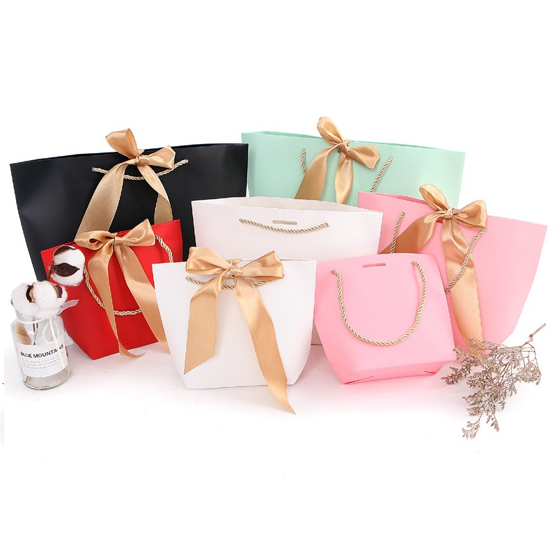 100pcs 4 Size <font><b>Large</b></font> Size Present <font><b>Box</b></font> For Clothes Books <font><b>Packaging</b></font> Gold Handle Paper <font><b>Box</b></font> Bags Kraft Paper <font><b>Gift</b></font> Bag With Handles image
