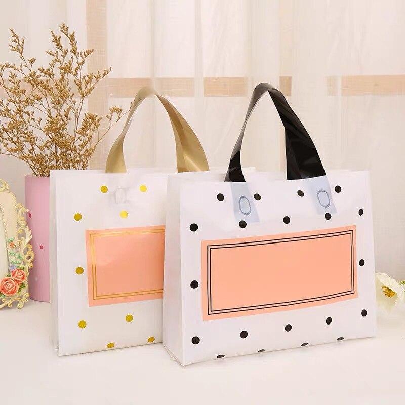 50pcs épais grands sacs en plastique 27x27cmWhite points ronds rose Shopping bijoux sacs demballage en plastique sac cadeau avec poignée