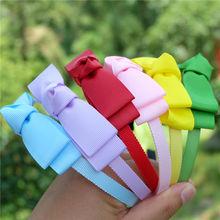 Детская пластиковая повязка на голову с большим бантом