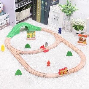 Image 1 - Детский набор игрушечного электрического поезда, магнитный игрушечный поезд с литыми отверстиями, деревянная железная дорога Bri o, трек для поезда, игрушки для детей, подарки