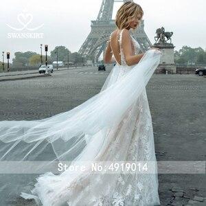 Image 2 - Fairy Lace Wedding Dress 2020 Swanskirt V neck Appliques A Line Flowers Princess Court Train Bride Gown vestido de noiva GY00
