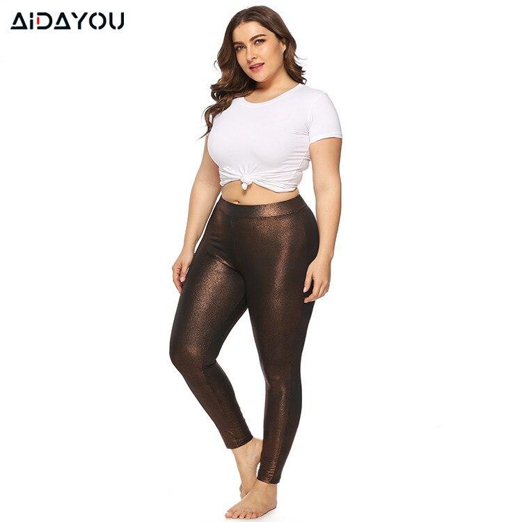 Bayan artı boyutu tayt katı renk moda seksi Slim-fit 5XL yüksek streç altın köpüklü spor tayt ouc3315
