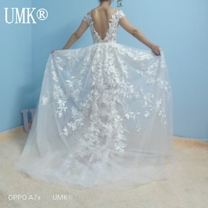 Image 3 - UMK High end Lace Mermaid Wedding Dress 2020 Sexy Backless Short Sleeve Detachable Train Wedding Gowns