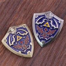 Clássico jogo zelda hylian crest broches azul esmalte pino triforce escudo lapela pinos crachá jóias acessórios