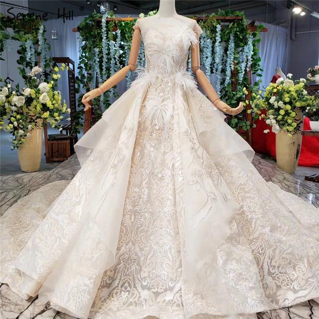 Champagne sans manches robes de mariée Sexy 2020 Dubai luxe paillettes plumes robes de mariée HX0005 sur mesure