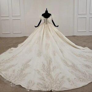 Image 3 - HTL1248 王女のウェディングドレス 2020 毛皮の襟縫製ビーズ上レーススカート背中自由奔放に生きるウェディングロングスリーブ vestido デ noiva