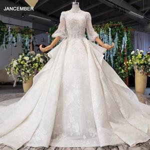 Image 1 - HTL984 boho weselny strój koronki pół rękawa latarnia koronki na szyję dziurka od klucza powrót luksusowe suknie ślubne wzburzyć pociąg vestido boda