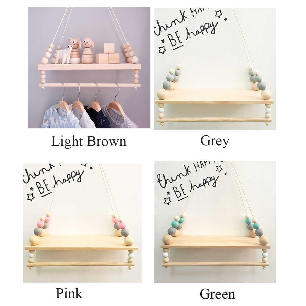 ชั้นวางแขวนตกแต่งไม้ห้องนั่งเล่น Nordic สไตล์เด็กห้อง Double Deck เสื้อผ้าจัดเก็บของขวัญลูกปัด Rack Home