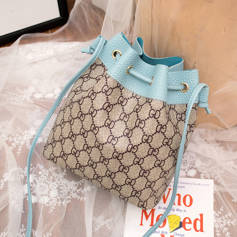 Small Bag New Style WOMEN'S Bag Embossed Leather Tassels Pull-belt Bucket Bag Girl'S Spring And Summer Shoulder Phone Coin Purse