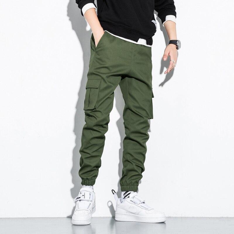 Mężczyźni wstążki Color Block z czarnymi kieszeniami Cargo spodnie do biegania w stylu Harem Harajuku spodnie dresowe spodnie Hip hopowe zagęścić