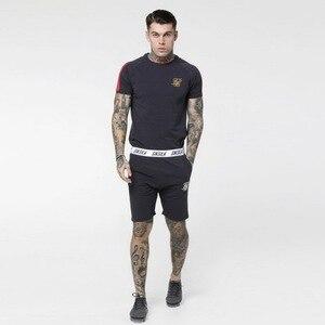 Marca de verano, pantalones cortos de algodón para hombre, pantalones cortos Sik de seda bordados para Fitness y culturismo, pantalones cortos informales para entrenamientos deportivos para hombre