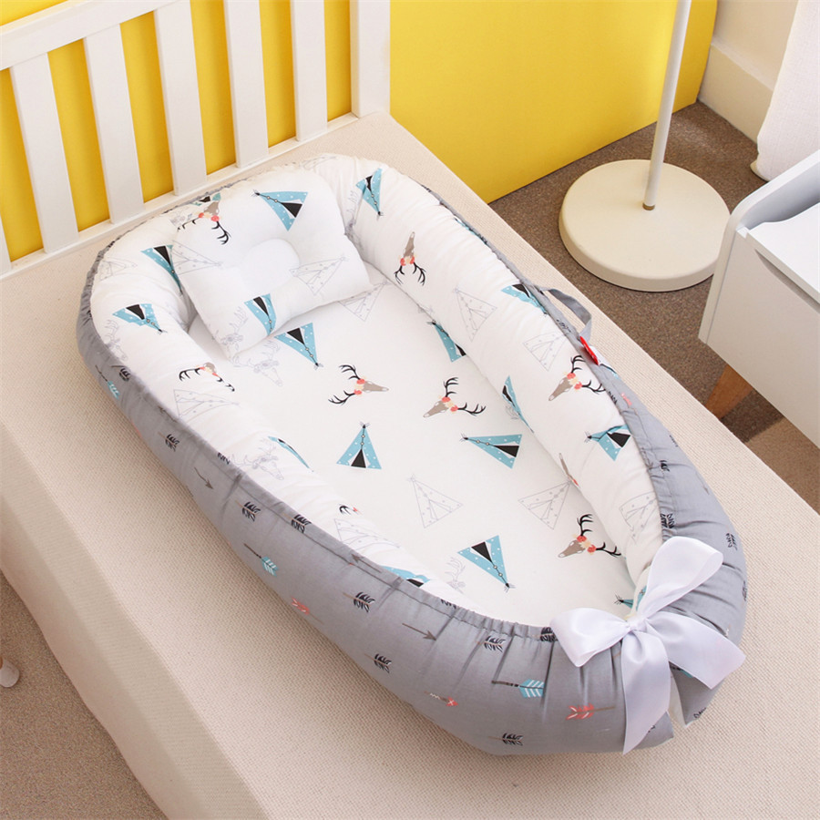 Portable removable and washable pressure-proof crib with bionic baby pillow and mommy holding travel crib baby safety fence
