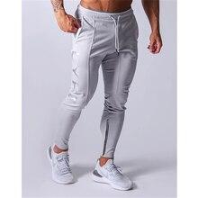 Pantalon de sport homme survêtement fitness pantalon de sport nouvelle mode imprimé muscle homme fitness pantalon d'entraînement