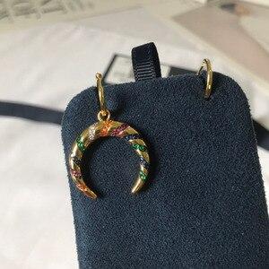 Image 1 - Umgodly moda brincos amarelo cor de ouro assimétrico multicolorido zircão listras lua crescente tribal brincos hoop feminino jóias