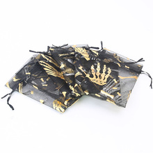100pcs Halloween bundle pocket 10 * 15cm personality hand bone organza candy bag party decoration gift