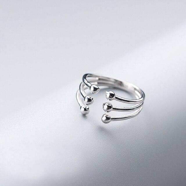 Фото модное глянцевое многослойное кольцо ginin из серебра 925 пробы цена