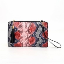 The new snakeskin envelope bag womens high-end hand-held long large-capacity fashion tassels handbag