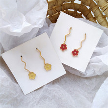 South Koreas geometry, yellow glazed girl flower earrings with female fashion curve wave The gift