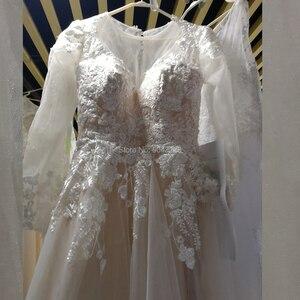 Image 1 - Romantyczne koronkowe aplikacje linia długie rękawy suknie ślubne 2020 z wycięciem przyciski powrót piętro długość suknia dla panny młodej szampana