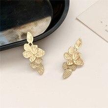 цена на Wearing Matte Gold Leaf Drop Earrings Geometric Earrings for Women Stylish Irregular Drop Earrings French New
