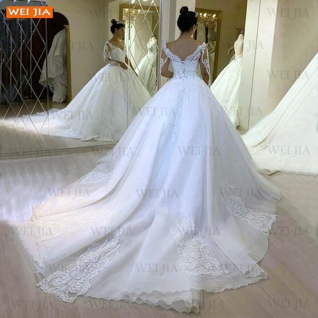 Luxury White Wedding Gowns 2021 Long Sleeves Lace Up Vestido De Noiva Appliqued Organza Ball Gown Bride Dresses Abito Da Sposa 2