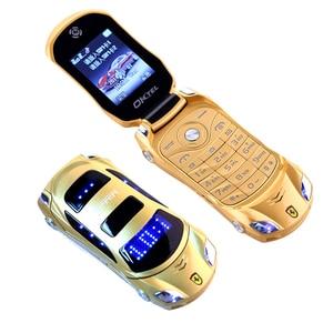 Image 1 - Newmind F15 Car Model Flashlight Dual Sim Cards Mp3 Mp4 FM Radio Recorder Flip Cellphone Car Model Mini Cell Mobile Phone P431