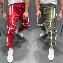 GYMOHYEAH jesień nowy Streetwear spodnie do fitnessu mężczyzn Hip Hop spodnie dresowe męskie na co dzień biegaczy Unisex Harajuku biegaczy spodnie dresowe tanie tanio Ołówek spodnie Poliester Nylon 38 - 42 Elastyczny pas Kostki długości spodnie Mieszkanie Lekki ck823 Pełnej długości