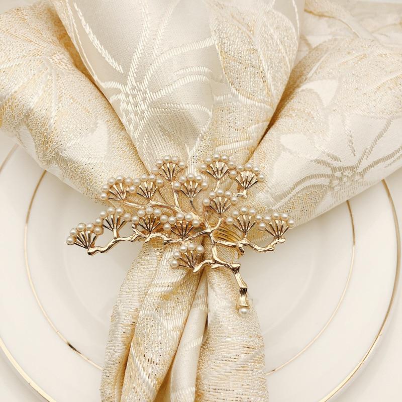 AliExpress Hot Sales Pine Can Jin Kou Pearl Alloy Napkin Rings Gold Napkin Ring Kou Bu Quan Manufacturers Wholesale