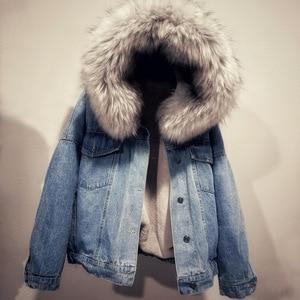 Image 1 - 女性ジーンズジャケット冬厚いジーンズジャケットフェイクファーの襟フリースフード付きデニムコート女性デニム Outwea