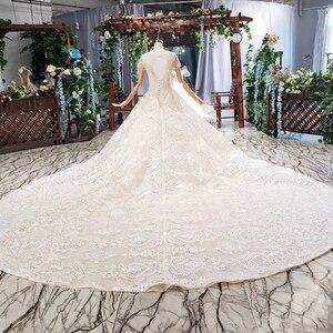 Image 2 - HTL670 ווסטרן תחרה חתונה שמלות אשליה o צוואר קצר שרוולים מחוך טול חתונת שמלת קריסטל חרוז robe דה mariee בוהם