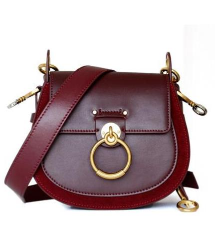 Leather saddle bag girl 2019 new retro wide shoulder strap cross body bag ring piglet spring and summer star bag with the same s