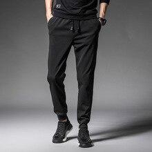 Алиэкспресс Лидер продаж мужская одежда партии осенние брюки винтового типа дизайн шнурок спортивные однотонные повседневные брюки K73