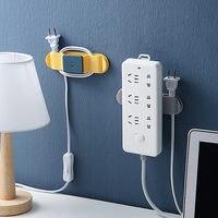 Punch-Freies Stecker Aufkleber Stecker Befestigung Gerät Selbst-adhesive Power Stecker Kabel Halterung Power Streifen Halter Abnehmbare Wand buchse Haken