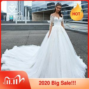 Image 1 - Swanskirt Appliques Hochzeit Kleid 2020 Langarm Spitze up Ballkleid Kapelle Zug Prinzessin Braut Kleid F117 Vestido de Noiva
