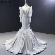 Dubai gris de lujo de manga larga vestidos de noche con cuello pico plumas rebordear brillante vestidos de noche 2020 Serene Hill HM66952